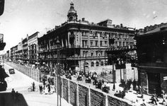 The entrance gate to the Warsaw Ghetto, and part of its surrounding wall, July 1942