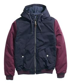Dark blue padded zip-up jacket with contrasting burgundy sleeves. Drawstring hood, quilted lining, and inner & outer pockets.│ H&M Divided Guys
