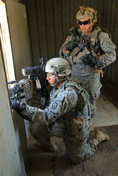 U.S. Army Soldiers from the A Company, 1st Battalion, 27th Infantry Regiment, pull security during Decisive Action Rotation 14-07 at the National Training Center  #USArmy