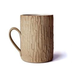 This classically shaped mug is hand carved by our potters to replicate those hewn beams seen in homes throughout the beautiful state of Vermont. Use our mug for your a.m. coffee or tea to transport yo