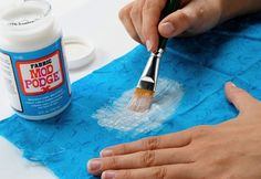 Fabric – Wash and dry the fabric (do not use fabric softener). Iron (if necessary) and then lay out on a covered work surface. Wax paper is preferable for covering your table. Using a brush, paint a light coat of Fabric Mod Podge onto your fabric. Allow to dry. This will allow you to cut the fabric like paper without frayed edges.