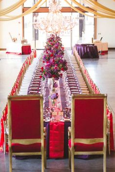 Estate table seating with exaggerated chairs at the head of the table for the grooms.