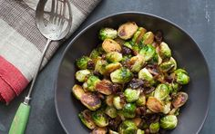 Sweet and Sour Brussels Sprouts // These super-flavorful sprouts with quick-pickled raisins are a snap to pull together and are just as delicious room temperature as warm from the pan. Enjoy for Thanksgiving!