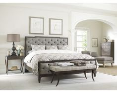 Hollywood Regency inspired bed with deeply hand-tufted headboard finished in nailhead. Set peninsula style on a wood frame.