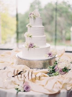 Featured photographer: Sposto Photography; wedding cake table