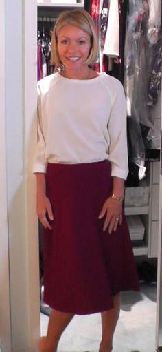 Kelly Ripa wore this white Tibi Top and Burgundy Prada skirt from Neiman Marcus.