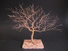 Wire Tree Of Life Sculpture Hand Sculpted With Tarnish Resistant Gold Jewelry Wire. $74.00, via Etsy.    I love this as a cake topper