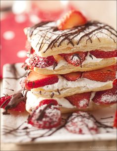 Strawberry Napoleons - puff pastry, sweet whipped cream and strawberries nestled in between layers of buttery puff pastry.