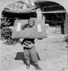 CHINA: PRISONER, c1900. - A captured prisoner from the Boxer Rebellion, locked in a cangue at a prison in Peking, China. Stereograph, c1900.