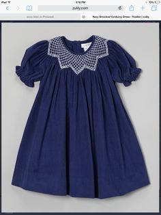 Petit Pomme is a boutique smocking line made exclusively for zulily. The name, which translates to ''little apple,'' was inspired by the signature chubby apple cheeks of smiley babies and toddlers. Navy Dress Outfits, Girl Outfits, Baby Dresses, Heirloom Sewing, Pretty Outfits, Pretty Clothes, Toddler Dress, A Boutique, Navy And White