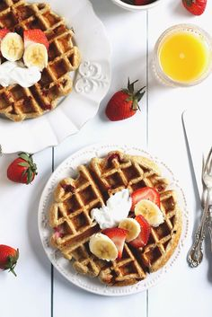 Healthy strawberry banana oatmeal greek yogurt waffles. The batter is made in the blender! Try them topped with peanut butter or extra greek yogurt!