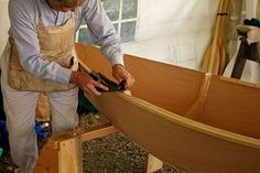 Wow. A wooden boat builder working his craft.