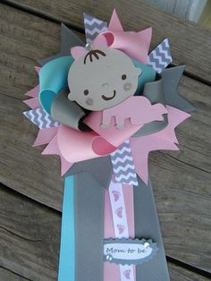 Can someone show me how to do this corsage for baby shower pls