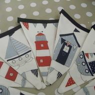 Gorgeous heavy cotton bunting using a jolly fabric covered in beach-huts, boats and lighthouses; bound with navy blue bias binding. Sold as a length, which contains 12 flags, each measuring approxiately wide x deep. Nautical Bedding Sets, Nautical Bunting, Nautical Bedroom, Sailboat Nursery, Fabric Bunting, Bunting Garland, Bunting Ideas, Buntings, Seaside Bedroom