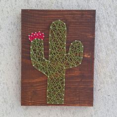 Measurements: 8.5x11.25  Background: dark walnut stain  String Color: green and pink  Display: comes ready to hang with a sawtooth picture hanger on back  I love custom orders and am more than happy to make this piece with whatever color board/string you would like! Please leave your color choices in the note to seller if you would like something other than what is pictured- all thread color options can be found on the last photo, or at the link below. http://www.yarntree.com/075dmcolors.jpg