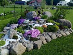 """The alpinarium (second name is «rock garden"""") is a popular element of landscape design; it is made from stone and unpretentious rock plants. The rock garden can Rock Garden Design, Garden Landscape Design, Yard Design, Landscape Edging, Landscape Designs, Landscaping With Rocks, Front Yard Landscaping, Landscaping Ideas, Hillside Landscaping"""