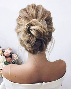 Amazing updo hairstyle with the wow factor. Finding just the right wedding hair for your wedding day is no small task but were about to make things a little bit easier.From soft and romantic to classic with modern twist these romantic wedding hairstyles with gorgeous details #weddinghairstyles #weddingdayhair