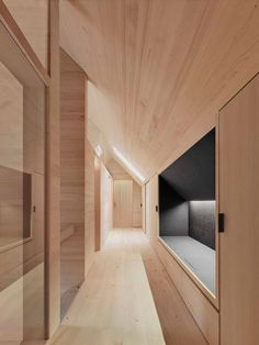 Haus am Moor is a minimalist house located in Krumbach, Austria, designed by Bernardo Bader Architects. Within the private forest of Schwarzenberg, the wood was selected, felled, cut, and installed. An overall of 60 spruces, firs and elms were used for construction panels, doors, floor structure and floor boards. (8)