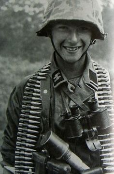 "A young SS soldier, likely of the 12th SS Panzer Divison ""Hitlerjugend"", a unit that took 43% of the casualties in the Normandy landings. Most were members of the Hitler Youth, earning it the nickname ""Baby Division"" by the Allies. Many were so young that rather than standard tobacco/ alcohol ration, they were given chocolate and sweets. In just under a year, the 20,540 members of the division had been whittled down to just 10,000, all of whom surrendered at Enns on May 8, 1945."