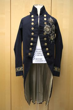 "Nelson's Undress Uniform 1795-1812  navy blue raised wool with cream twill silk lining. According to the National Maritime Museum Collection's blog a ""relatively plain tail-coat."