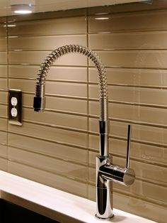 Backsplash of glass tile. Modern Kitchens from Davida Rodriguez on HGTV