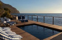 Can you imagine that this exquisite luxury beachfront location is close to Cape Town? Tintswalo Atlantic is a perfect romantic getaway Best Hotels, Luxury Hotels, Dark Places, Fishing Villages, Romantic Getaway, Africa Travel, Luxury Living, Cape Town, Day Trip