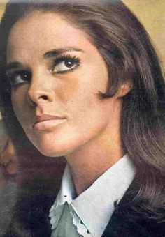 Ali MacGraw 1968. Look at the little 'eyelet' type edging on blouse collar. Nude lipstick. And that curl in front of ear. How popular that was!