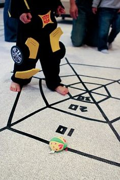 bug party activity   spider web toss.  Bean bag toss game on the floor using electrical tape.