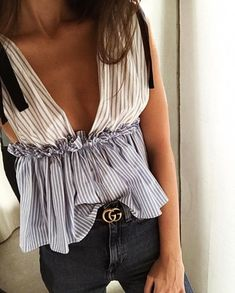 $55 Cute Sexy Cut Out Low Plunge V-Neck Blue And White Striped Ruffled Sleeveless Summer Blouse With Gold Buckle Belt And Black Denim Jeans