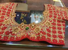 bridal blouse design in red and gold