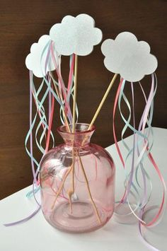 These rainbow and cloud wands are adorable! I want them for party favors at Ella\'s Unicorn Party! The kids will love playing with them.