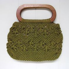 * Jute tote bag c1970s * Olive green * Macrame pattern * Large oval wooden handles * Brown rayon lining has interior side pocket No label