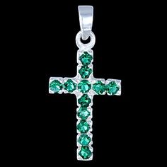 delicate silver cross, set with green zirconia $31.06