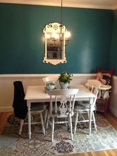 Teal and white dining room