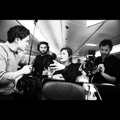 Actor Ben Feldman takes direction from Kat Coiro onboard a Virgin Australia flight to make 'Departure Date.'