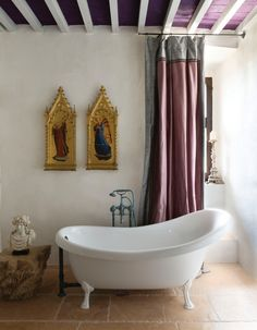 MLB in Umbria Gilded gothic panels and a marble bust of Bacchus brings art into the bathroom