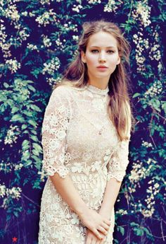Jennifer Lawrence in a totally different look than everything I've seen her in. Loving the lace and lush greenery.