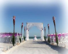 Florida beach wedding perfection from Suncoast Weddings ... violet sashes and starfish feature .... simply stunning!
