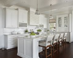 Marianne Jones: Fabulous white kitchen design with white shaker cabinets paired with beveled marble ...