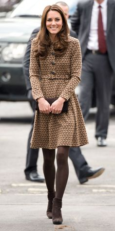FEBRUARY 21, 2012 The Duchess visited Rose Hill Primary School in Oxford, England to promote the children's art therapy organization The Art Room in an Orla Kiely bird print dress, brown tights, and brown ankle boots by Aquatalia.