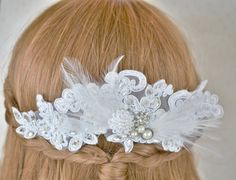 Lace Hair Comb ~  White Bridal Hair Piece ~ Feather Hair Comb ~ Wedding Head Piece ~ by BlissInBloom.etsy.com ~ This lace hair comb is richly embellished with shimmering crystals and wispy feathers, resembling angel wings, that will take your breath away. Pearl adornments are carefully placed on this bridal hair comb to add classic elegance. Wear this statement piece to frame your bridal chignon or long cascading curls for a luxurious look.
