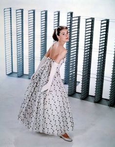 Audrey Hepburn wears a white and silver dress in Funny Face promo, with flats and long gloves.