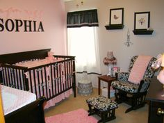 So cute...I love the pink accent wall w/ dark, bold letters & damask patterned chair