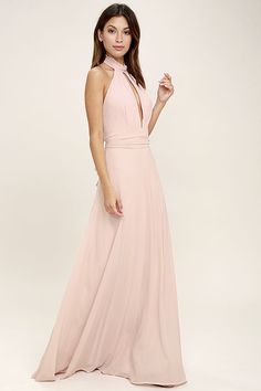 Endless romance always follows an appearance of the First Comes Love Blush Pink Maxi Dress! Woven poly sweeps from a ruffled, halter neckline into a backless bodice with pleated detail and a keyhole cutout. Tying sash wraps around the waist above a cascading maxi skirt. Hidden back zipper/clasp.