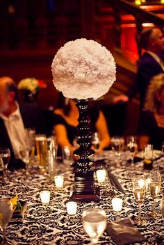 Can be done with carnations or with tissue paper as a non-floral centerpiece
