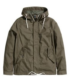 Parka in washed cotton canvas with lined drawstring hood. Zip and wind flap with concealed snap fasteners at front, side pockets with flap and snap fastener, and tab and snap fastener at cuffs. Drawstring at hem. Unlined.