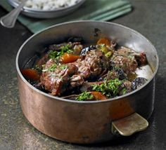 Slow-cooked rabbit stew with brandy, red wine, and more.