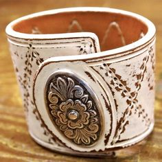 distressed leather cuff with medallian