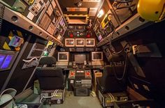 This attic was transformed into what looks like something straight out of an 80s sci-fi movie set. The old-school spaceship cockpit feeling was recreated with a bunch of old monitors, pilot seats, police tape, buttons and many more devices.