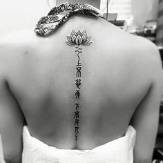 Lotus is yet another symbol that is rich in meaning. Some of these are renewal and life. In this design however, the lotus is not alone. It's accompanied by letters from an ancient language and could mean something to you.